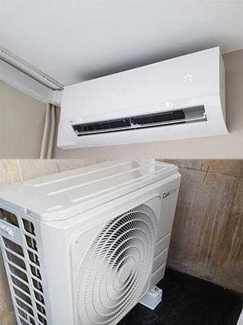 photo d'un climatiseur coolsmart blanc accroché au mur avec son moteur en bas